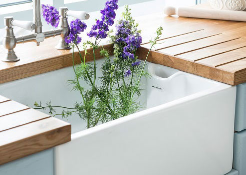 A Belfast sink alongside a prime oak worktop with drainage grooves routed in