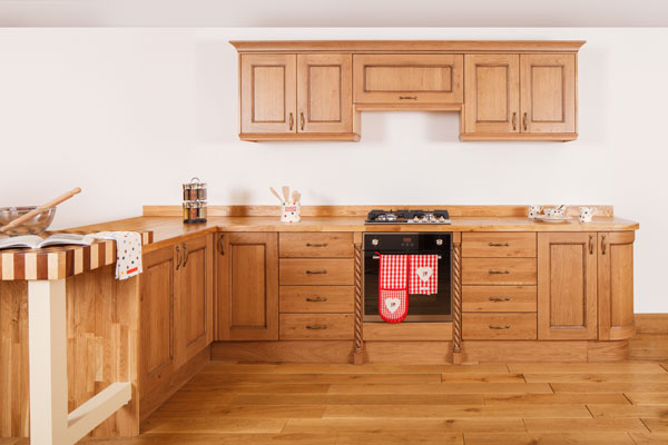 Traditional lacquered oak cabinets and solid oak worktops with corner cabinets and pilasters